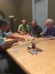 Mike Thomas dealing a poker hand to James Eddy, Steve Tanner BLHS Class of '66, and Tony Anderson. Sept 2017